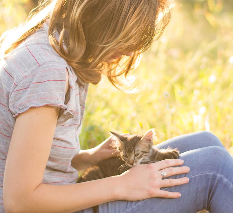girl-with-kitten-sitting-outside